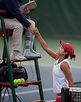 STANFORD, CA - January 26, 2011: Hilary Barte of Stanford women's tennis shakes hands after her match against UC Davis' Dahra Zamudio. Barte won 6-2, 6-0.