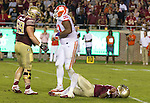 Clemson defensive tackle Dexter Lawrence (90) walks away from Florida State quarterback Deondre Francois after a hit in the backfield in the second half of an NCAA college football game in Tallahassee, Fla., Saturday, Oct. 29,2016. Clemson defeated Florida State 37-34. (AP Photo/Mark Wallheiser)