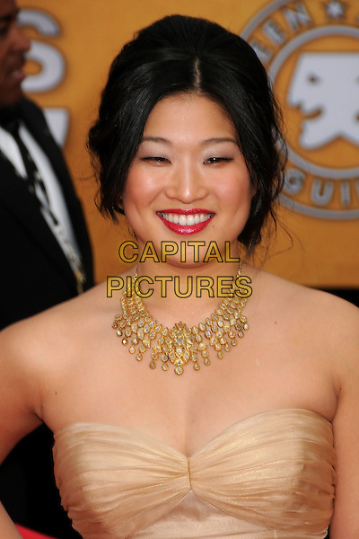 JENNA USHKOWITZ.17th Annual Screen Actors Guild Awards held at The Shrine Auditorium, Los Angeles, California, USA..January 30th, 2011.arrivals headshot portrait necklace red lipstick make-up smiling strapless beige  .CAP/ADM/BP.©Byron Purvis/AdMedia/Capital Pictures.