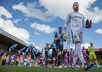 Goalkeeper Matt Ingram of Wycombe Wanderers followed by teammates as they head onto the field during the Sky Bet League 2 match between Wycombe Wanderers and Plymouth Argyle at Adams Park, High Wycombe, England on 12 September 2015. Photo by Andy Rowland.