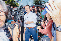 South Bend mayor and Democratic presidential candidate Pete Buttigieg greets people as he walks through the Iowa State Fair in Des Moines, Iowa, on Tues., Aug. 13, 2019.