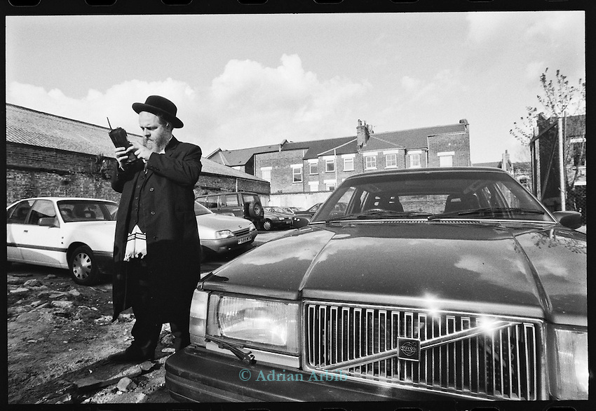 Zalmy, a car salesman in his yard,   Stamford Hill  North London