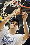 19 MAR 2011:  Tommy Hannon (44) of the University of St. Thomas (Minnesota) cuts down the net after defeating the College of Wooster during the Division III Men's Basketball Championship held at the Salem Civic Center in Salem, VA. The University of St. Thomas (Minnesota) defeated College of Wooster 78-54 to win the national title.  Andres Alonso/NCAA Photos