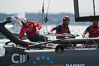 25 July 2015: Sir Ben Ainslie, skipper Land Rover BAR during the America's Cup first round racing off Portsmouth, England (Photo by Rob Munro)