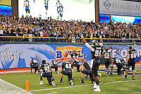 20 December 2011:  FIU players kneel in the end zone nearest their fans  after taking the field.  The Marshall University Thundering Herd defeated the FIU Golden Panthers, 20-10, to win the Beef 'O'Brady's St. Petersburg Bowl at Tropicana Field in St. Petersburg, Florida.