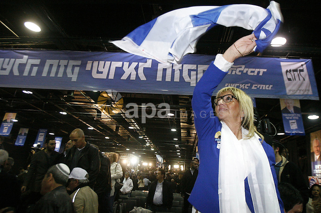 "Supporters of Israeli Prime Minister and chairman of the Likud party Benjamin Netanyahu party celebrate election results in Tel Aviv early on January 23, 2013 after his Likud-Beitenu list won the Israeli general election. Netanyahu said it was necessary to form the ""broadest possible government"" after his Likud-Beitenu list won a narrow election victory, with the centrist Yesh Atid in second place. Photo by Mahfouz Abu Turk"