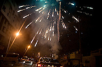 Sparks from fireworks marking the end of the Lunar New Year festival rain down on cars in Nanjing, China.