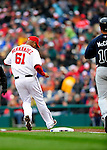 31 March 2011: Washington Nationals starting pitcher Livan Hernandez makes an unassisted out at first on Opening Day against the Atlanta Braves at Nationals Park in Washington, District of Columbia. The Braves shut out the Nationals 2-0 to open the 2011 Major League Baseball season. Mandatory Credit: Ed Wolfstein Photo