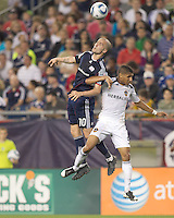 New England Revolution forward Rajko Lekic (10) and Los Angeles Galaxy defender Sean Franklin (5) battle for head ball. In a Major League Soccer (MLS) match, the Los Angeles Galaxy defeated the New England Revolution, 1-0, at Gillette Stadium on May 28, 2011.