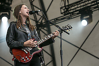 20th July 2014: American pop rock band Haim play the Obelisk Arena on the fourth day of the 9th edition of the Latitude Festival, Henham Park, Suffolk.<br /> Este Arielle <br /> Danielle Sari <br /> Alana Mychal Haim <br /> drummer Dash Hutton<br /> Picture by Stuart Hogben