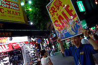 For sale signs are touted in the summer sales in Shinjuku ward, Tokyo, Japan. Consumer spending is on the increase in Japan. The Japanese economy is finally emerging from over a decade of economic recession..