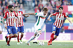 Atletico de Madrid's Augusto Fernandez (l), Angel Correa (b) and Oliver Torres (r) and Granada Club de Futbol's Adalberto Penaranda during La Liga match. April 17,2016. (ALTERPHOTOS/Acero)