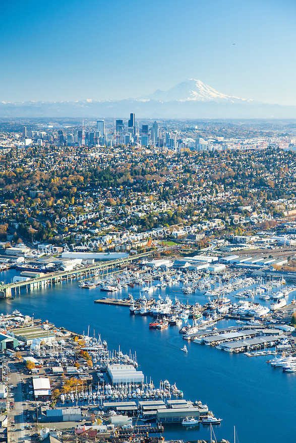 Aerial photo of marinas and the Fremont Bridge with the Seattle skyline and Mount Rainier in the background
