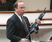 Defense attorney Peter Greenspun holds the Bushmaster rifle used in the sniper shootings during his closing argument in the trial of sniper suspect John Allen Muhammad at the Virginia Beach Circuit Court in Virginia Beach, Virginia on November 13, 2003. <br /> Credit: Steve Earley - Pool via CNP