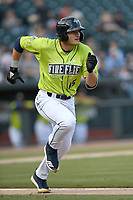 Catcher Hayden Senger (15) of the Columbia Fireflies runs toward first base in a game against the Charleston RiverDogs on Saturday, April 6, 2019, at Segra Park in Columbia, South Carolina. Columbia won, 3-2. (Tom Priddy/Four Seam Images)