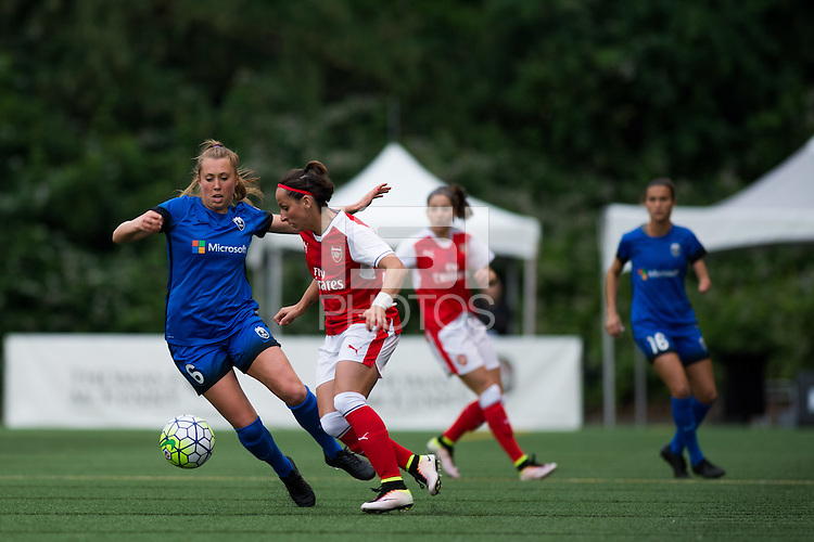 Seattle, WA - Thursday, May 26, 2016: Seattle Reign FC midfielder Lindsay Elston (6) and Marta Corredera (17) Arsenal Ladies FC. The Seattle Reign FC of the National Women's Soccer League (NWSL) and the Arsenal Ladies FC of the Women's Super League (FA WSL) played to a 1-1 tie during an international friendly at Memorial Stadium.