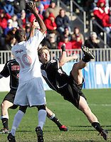 New Mexico's Jeff Rowland (6) has a shot blocked by the arms of Maryland's Maurice Edu (10) in the penalty area.  A penalty kick was awarded, but was saved. The University of Maryland defeated the University of New Mexico 1-0 in the NCAA Final at SAS Stadium in Cary, North Carolina, Sunday, December 11, 2005.