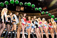 "The Wingettes face off for the title of Ms. Wing Bowl at the 14th annual Wing Bowl, held in Philadelphia on February 3, 2006 at the Wachovia Center.<br /> <br /> The Wing Bowl is a competitive eating event in which eaters try and down the most hot wings in 30 total minutes in front of a crowd of 10,000 plus people.  The real show however is all around the eaters, from the various scantily clad women (known as ""Wingettes"") that make up eaters' entourages, to the behavior of the fans themselves."
