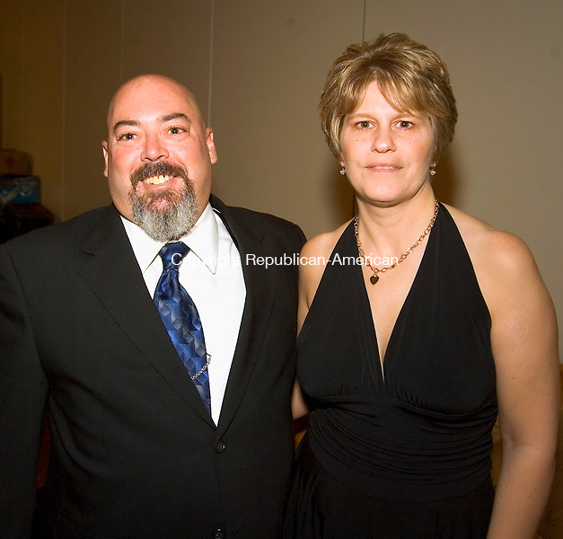 WATERTOWN, CT--05 MAY 2007--050507JS21-Ed Bailly, a former Chief and Firemans Ball chairman with his wife Cheri Bailly at the Middlebury Volunteer Fire Department annual ball held at the Grand Oak Villa in Watertown. <br /> Jim Shannon/Republican-American
