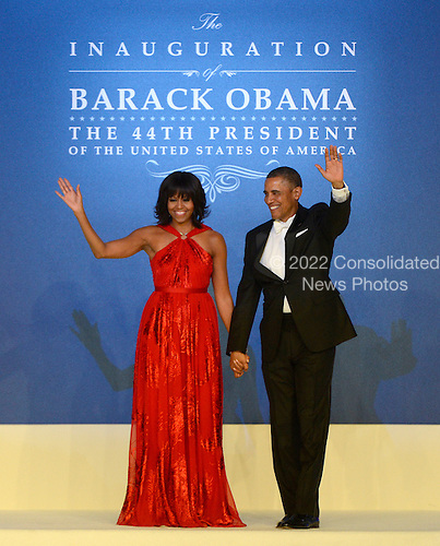 United States President Barack Obama and first lady Michelle Obama appear at the Inaugural Ball at the Washington Convention Center in .Washington, D.C. on Monday, January 21, 2013..Credit: Ron Sachs / CNP.(RESTRICTION: NO New York or New Jersey Newspapers or newspapers within a 75 mile radius of New York City)