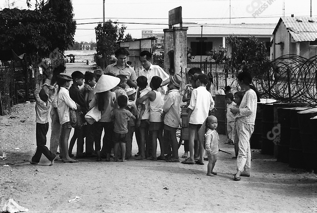 Pham Xuan An, Time magazine staffer in Saigon (and Viet Cong agent), at a refugee camp near Danang (right). On the left is Jon Larsen, then Saigon Bureau chief of Time magazine. Danang, May 1971.