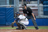 Danville Braves catcher Carlos Martinez (8) catches a pitch as home plate umpire Zach Neff looks on during the game against the Burlington Royals at American Legion Post 325 Field on August 16, 2016 in Danville, Virginia.  The game was suspended due to a power outage with the Royals leading the Braves 4-1.  (Brian Westerholt/Four Seam Images)