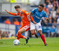 Portsmouth's Nathan Thompson (right) vies for possession with Shrewsbury Town's Alex Gilliead (left) <br /> <br /> Photographer David Horton/CameraSport<br /> <br /> The EFL Sky Bet League One - Portsmouth v Shrewsbury Town - Saturday September 8th 2018 - Fratton Park - Portsmouth<br /> <br /> World Copyright &copy; 2018 CameraSport. All rights reserved. 43 Linden Ave. Countesthorpe. Leicester. England. LE8 5PG - Tel: +44 (0) 116 277 4147 - admin@camerasport.com - www.camerasport.com
