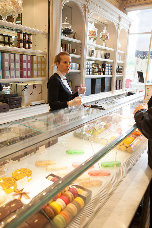 Saleswoman speaks with customers at Angelina, Rivoli Street, Rue de Rivoli, Paris, France, Europe