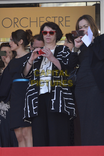 CANNES, FRANCE - MAY 15: Shane Spall,  wife of Timothy Spall looking on and taking photos from the top of the red carpet during arrivals at the 'Mr Turner' premiere during the 67th Annual Cannes Film Festival on May 15, 2014 in Cannes, France.<br /> CAP/PL<br /> &copy;Phil Loftus/Capital Pictures