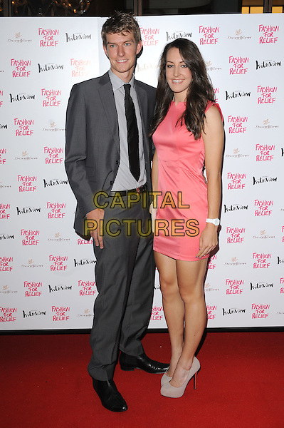 guest & Dani King.The Fashion For Relief Charity Dinner hosted by Naomi Campbell at Downtown Mayfair, London, England..9th August 2012.full length grey gray suit pink dress sleeveless .CAP/BEL.©Tom Belcher/Capital Pictures.