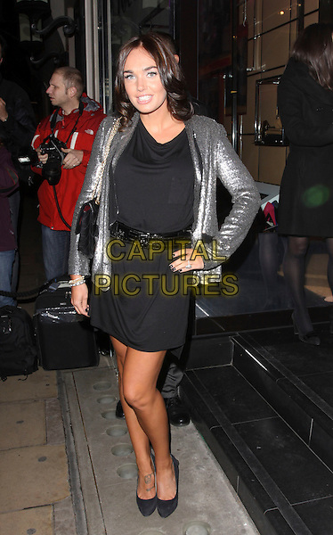TAMARA ECCLESTONE.Attending The Italian Touch launch reception, Tod's Boutique, Old Bond Street, London, England, UK, .November 4th 3009..full length sequined sequin jacket black dress shoes hand on hip tattoo on foot chanel shoulder bag gold chain strap .CAP/AH.©Adam Houghton/Capital Pictures.
