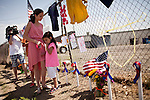 Trinity, left, and Skyler Trujillo pay their respects at a makeshift memorial outside Fire Station 7 in Prescott, Arizona, July 2, 2013, the home of the 19 Granite Mountain Hotshots who perished in the Yarnell Fire Sunday.