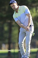 Josh Duhamel chips onto the 1st green during Thursday's Round 1 of the 2018 AT&amp;T Pebble Beach Pro-Am, held over 3 courses Pebble Beach, Spyglass Hill and Monterey, California, USA. 8th February 2018.<br /> Picture: Eoin Clarke | Golffile<br /> <br /> <br /> All photos usage must carry mandatory copyright credit (&copy; Golffile | Eoin Clarke)