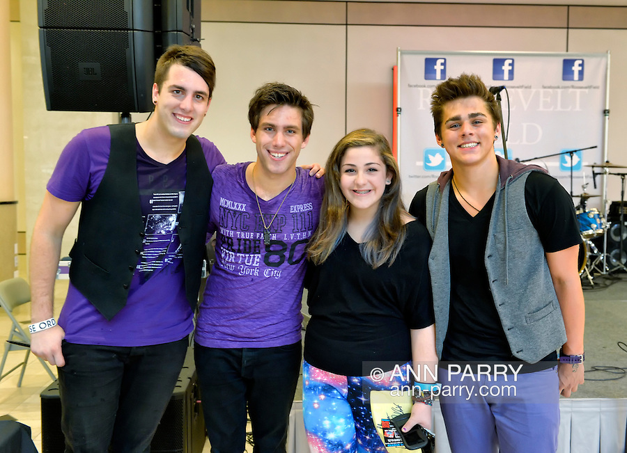 Garden City, New York, USA. 15th August 2013.  CRUISE RUSSO, DREW KATSOCK, and JOHN RUSSO of Reverse Order, the Grammy nominated pop rock band, pose with fans, at center AVA LEONE, 12, of Albertson, at BACK AT IT, a Back-to-School event at Roosevelt Field shopping mall, which is one of the 10 largest shopping malls in the United States of America.
