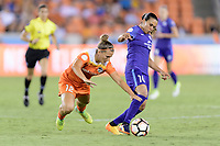 Houston, TX - Saturday June 17, 2017: Amber Brooks trips while attempting to get the ball from Marta Vieira Da Silva during a regular season National Women's Soccer League (NWSL) match between the Houston Dash and the Orlando Pride at BBVA Compass Stadium.