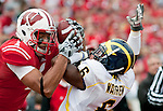 November 14, 2009: Wisconsin Badgers wide receiver Nick Toon (1) catches a touchdown pass as Michigan Wolverines defensive back Donovan Warren (6) defends during an NCAA football game at Camp Randall Stadium on November 14, 2009 in Madison, Wisconsin. The Badgers won 45-24. (Photo by David Stluka)