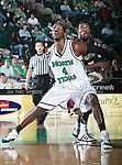North Texas Mean Green forward George Odufuwa (4) in action during the NCAA  basketball game between the University of Louisiana at Monroe Warhawks and the University of North Texas Mean Green at the North Texas Coliseum,the Super Pit, in Denton, Texas. ULM defeated UNT 82 to 75...