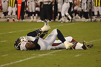Aug. 31, 2006; Glendale, AZ, USA; Denver Broncos linebacker (54) Patrick Chukwurah lays on the ground injured against the Arizona Cardinals at Cardinals Stadium in Glendale, AZ. Mandatory Credit: Mark J. Rebilas