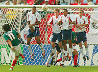 Mexico's Braulio Luna attempts a free kick as Tony Sanneh, Brian McBride, Pablo Mastroeni and John O'Brien defend. The USA defeated Mexico 2-0 in the Round of 16 of the FIFA World Cup 2002 in South Korea on June 17, 2002.