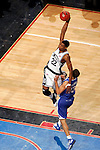 Connecticut forward Rudy Gay (22) dunks over Kentucky forward Bobby Perry (13).  Connecticut defeated Kentucky 87-83 in the second round of the NCAA Tournament  at the Wachovia Center in Philadelphia, Pennsylvania on March 19, 2006.