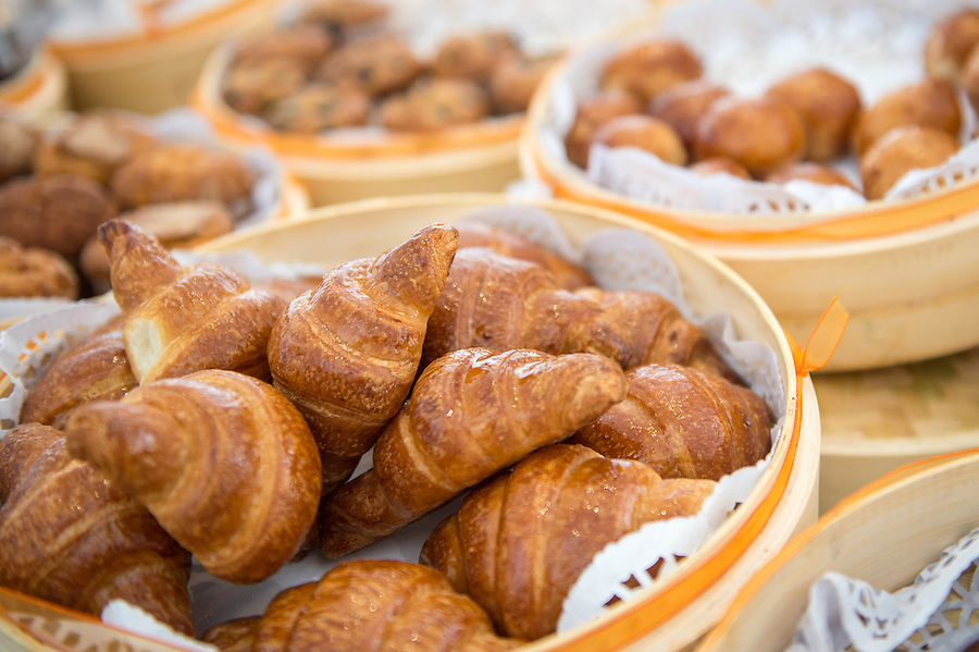 Basket with croissants  served in a buffet with space for copy on top.