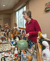 NWA Democrat-Gazette/BEN GOFF @NWABENGOFF<br /> Joan Bachman of Fayetteville shows her collection of bowling memorabilia Saturday, Jan. 12, 2019, during the annual collectors day 'Cabin Fever Reliever' at the Shiloh Museum of Ozark History in Springdale. Dozens of local collectors set up tables showcasing their collections of such various things as kitchen utensils, coins, buttons, hand fans, fossils woodcarving and much more.