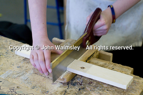 Sawing wood to length, Design Technology class, state secondary school.