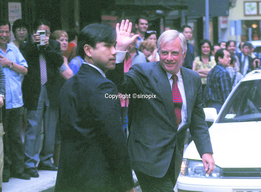090597: CHRIS PATTEN : HONG KONG<br /> <br /> The Last  Governor of Hong Kong, Chris Patten greets the crowds after dining in Central.