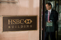 A man exits the HSBC building in Toronto financial district April 20, 2010. HSBC Holdings plc is a United Kingdom-based public limited company incorporated in the UK in 1990 following its name change from The Hongkong and Shanghai Banking Corporation, and headquartered in London since 1993.