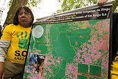 9 June 2014. Kayapo Chief Megaron Txucarramae during his visit to London. The chief holds a map of the Xingu River basin which shows the amount of deforestation and has the indigenous territories marked on it.