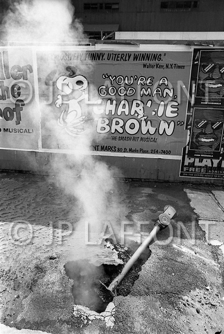 Manhattan, New York City, NY. 1973. <br /> Charlie Brown's sign and broken parking meter on the sidewalk. The Lower East Side street was under repair.