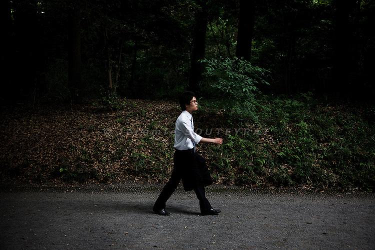 Tokyo, June 2 2012 - A salaryman on his way to Meiji Jingu shrine.