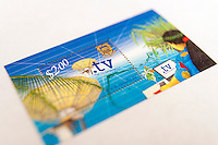 A two dollar stamp from the island nation of Tuvalu commemorates its .tv domain name. (© Richard B. Levine)