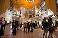 "Visitors to Grand Central Terminal stand in awe at Target's two-story, 1,540 square foot ""dollhouse"" constructed in Vanderbilt Hall on Monday, May 6, 2013. The house includes full size rooms filled with Target products promoting their ""Threshold"" line of home goods. The promotional stunt will only be there for two days when it will be disassembled with all the products being donated to charity. (© Richard B. Levine)"